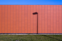 Orange wall and a shadow of a street lamp (Jan van der Wolf) Tags: map13642v wall muur shadow lines streetlamp composition streetlight lijnen gebouw building