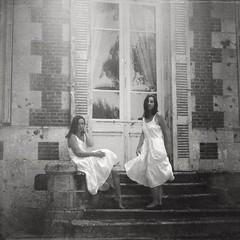 """She was always a little crazy, you know?"" (soleá) Tags: whitedress women girls square fauxvintage bnw clones unheimisch sisters twins fineart fineartstorage carmengonzalez soleá"