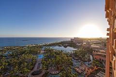 Atlantis resort at sunset (Tambako the Jaguar) Tags: sunset garden pools beach sea ocean trees morning sun sky building tower royaltower landsape atlantisresort paradiseisland nassau bahamas hotel vacation luxury nikon d5