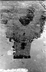 San Juan en los charcos (rodrigo.blackburn) Tags: blackandwhite reflection water rain puddle spain d76 burgos convent castillaylen fujiacross100 olympusom2n nikoncoolscaniv zuiko50mm18