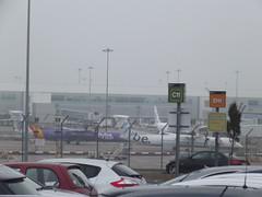 Birmingham Airport - Flybe planes (ell brown) Tags: greatbritain england fog plane birmingham unitedkingdom planes carpark westmidlands solihull ncp birminghamairport c11 flybe bhx d11 bombardierdash8q400