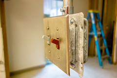 light switch ready to get enclosed into wall during construction (DigiDreamGrafix.com) Tags: light white house blur building home closeup switch blurry construction power interior off flip inside isolation lightswitch flipping powerswitch isolate