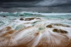 Lumpy (Crouchy69) Tags: ocean sea sky seascape storm motion beach water rain clouds sunrise landscape flow dawn coast sand rocks waves sydney australia turimetta