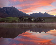 The Oaks Sunrise Colour Explosion (Panorama Paul) Tags: sunrise reflections southafrica dam westerncape overberg greyton nikkorlenses nikfilters vertorama nikond800 wwwpaulbruinscoza paulbruinsphotography theoaksestate