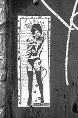 cuddling the cocktails monochrome (PDKImages) Tags: art street manchesterstreetgallery manchesterstreetart streetart contrasts couple love artinthecity ripartist faces abandoned girl bee bees manchester walls posterart stencilart heart hidden dmstff cityscape cityscene