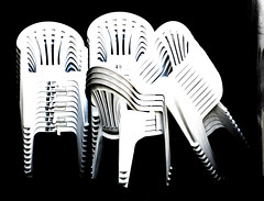 The Unused Chairs (Steve Taylor (Photography)) Tags: stacked leaning label art digital chair black blue contrast white plastic newzealand nz southisland canterbury christchurch cbd city pattern