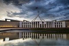 heart of canberra (nzfisher) Tags: canberra capital parliament parliamenthouse reflection structure architecture building flag australia sunset sundown dusk twilight sky clouds cloudy stormy 24mm canon