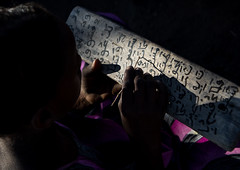 Afar tribe girl writing on a wood board in a coranic school, Afar region, Afambo, Ethiopia (Eric Lafforgue) Tags: afambo afar africa africanethnicity arabic board calligraphy child colourpicture coran coranicschool danakil day education ethio17237 ethiopia girl horizontal hornofafrica ink islam islamic koran kuran learning madrasah madrassa madrassah muslim onegirlonly oneperson outdoors pastoralist pupil quran realpeople religion religious school student tribal tribe wood woodboard worship writing afarregion et