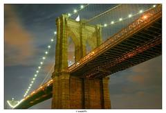 Brooklyn Bridge by a Full Moon Night (Arnold Pouteau's) Tags: nyc newyorkcity longexposure bridge newyork cloudy manhattan moonlight nigh f50 brookllyn