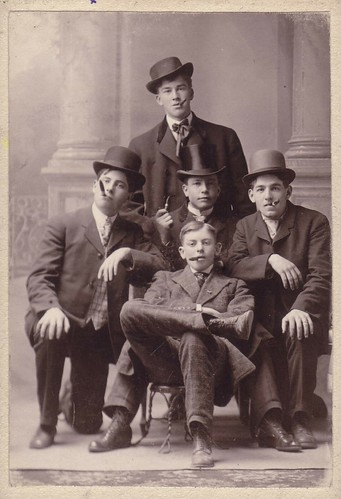 very old picture of young men with cigars