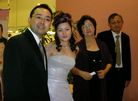 Sister's wedding - newlyweds with parents