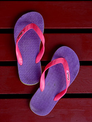 grandma's slippers  (Watari Goro ) Tags: grandma topf25 hawaii colorful sandals  flipflops slippers tutu  thecontinuum interestingness327 i500 top20hawaii   slippahz