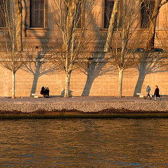 Winter Afternoon along the Quais, Paris (Rita Crane Photography) Tags: trees friends light sunlight paris france water taggedout reflections bravo afternoon shadows stock explore urbanlandscape thelouvre stockphotography laseine goldenglow lateafternoonlight squarephoto 500x500 visitparis75001 alongthequais ritacrane quaifrancoismitterand ritacranephotography wwwritacranestudiocom bachspicsgallery peoplealongthequais