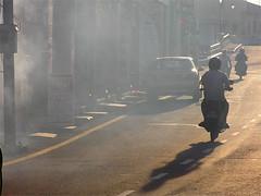 Smokin' (Frankss) Tags: auto street light red sun white black colors car bike silhouette backlight dark fire grey back twilight lowlight warm colours shadows cloudy dusk motorbike malaysia backlit hazy melaka malacca