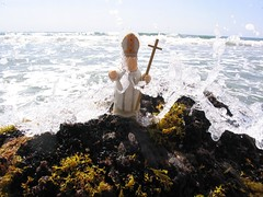 The Pope getting hit by a wave on a rock (The Traveling Pope) Tags: pope island travels block mattatuck