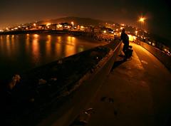 shadow fishing (seanhoyer) Tags: ocean longexposure shadow 20d water silhouette night canon pier fishing fisherman streetlights fisheye pacifica sodiumvapordreams top500 pacificapier explored sigma8mm