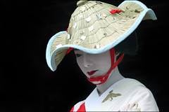 Hat: Gion Matsuri   (mboogiedown) Tags: travel red summer woman white topf25 girl beautiful beauty hat festival japan mystery neck asian japanese interestingness kyoto shrine asia 500v20f traditional culture july lips explore maiko geiko geisha    gion procession tradition  kansai   matsuri jinja cultural yasakashrine   elegance  hanagasa     yasaka shijo  yokoso     bijin mapjapan   gionmatsuri    beuaty     interestingness50 i500  yokosojapan  gtaggroup goddaym1 flowerandwillowworld karyukai   shijodori  kyorestu     geikoofgion flowerprocession festivalofgion