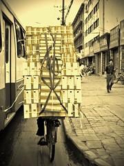 Shoe Salesman (Pat Rioux) Tags: china street people bus bike bicycle shoes chengdu boxes sichuan