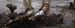 girls mud volleyball (Khushroo Ghadiali) Tags: brown wet girl topv111 ball mouth fly flying eyes mud dive tshirt fair spray dirt volleyball shut sprinkle topphotoblog abigfave