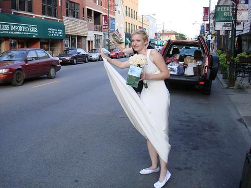 Bride hailing a taxi