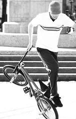 More Bike Tricks (Thomas Hawk) Tags: blackandwhite bw man male hat bike bicycle wheel shirt stairs blackwhite shoes top seat stonework steps sneakers jeans embarcadero trousers trick plain striped laces pedal handlebars