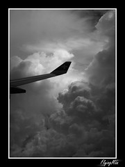 Cloud Junkie 3 - Flying to the danger zone (flyingMan) Tags: sky bw cloud white black plane view wing lot monotone aerial widok chmury niebo samolot skrzydo