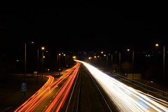 Night Traffic (Andrew Laws) Tags: night lowlight lanes road motorway highway longexposure exposure nikon nikkor 50mm f18 lights red white blue traffic cars vehicles