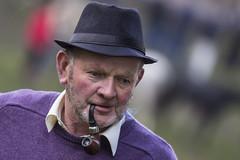Pipe man in purple (Frank Fullard) Tags: street ireland portrait horse irish hat purple candid smoke pipe fair smoker tobacco ballinasloe horsefair fullard frankfullard