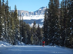 Moraine Lake Road Cross Country Ski - Larry with mountains to the east (benlarhome) Tags: winter snow canada ice rockies nationalpark path crosscountry trail alberta rockymountain banff lakelouise moraine kanada morainelake crosscountryski schi
