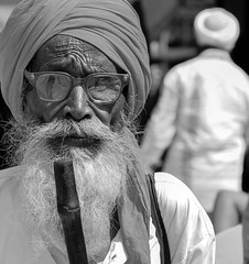 But, Why? (ybiberman) Tags: portrait bw india man beard pain candid streetphotography walkingstick varanasi turban eyeglasses sadhu