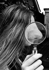Nosey (AmeliaIsobel) Tags: white distortion black glass girl monochrome face outside nose hand surreal magnifying