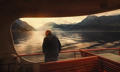 boat trip (Chrisnaton) Tags: switzerland vierwaldstättersee lake mountains morningsun morningmood onthelake boattrip fredy lifebelt redbench staringatthelake journey