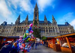 Christmas Market in Vienna, Austria (` Toshio ') Tags: toshio vienna austria christmasmarket rathaus cityhall christmastree shops people december sky clouds balloons europe european europeanunion fujixe2 xe2