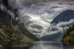 "The fjord near Gudvangen (wimvandemeerendonk, quite busy at the moment with ) Tags: clouds cloud cloudscape forest fjord green heaven hill landscape light mountain mountainscape nature norway outdoors outdoor panorama reflection rock rocks ripples sony sky tree trees wimvandem water jetty waterfall waterfalls falls fall ""flickrtravelaward"" rockpaper astoundingimage daarklands 650699faves"
