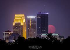 Red Moon Rising (Greg Lundgren Photography) Tags: red urban moon minnesota skyline night fire smog cityscape minneapolis fullmoon moonrise wellsfargo twincities ids capella greglundgren onlyinmn
