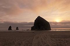 Cannon Beach (pdx104) Tags: ocean sun beach water clouds oregon rocks shoreline cannon