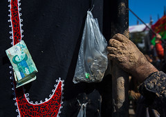 iranian shiite muslim woman hand covered in mud during ashura, the day of the death of imam hussein, Kurdistan Province, Bijar, Iran (Eric Lafforgue) Tags: street people money festival horizontal religious outdoors sadness clothing veiled veil mourning mud iran muslim islam traditional religion ceremony middleeast persia celebration offering shia ritual muharram ashura iranian muslims hussein islamic burqa imam iman banknote commemoration kurdish kurd kurds shiite ashoura hussain hoessein chador achoura persiangulfstates khomeini smallgroupofpeople   15636 husayn colourimage  iro kurdistanprovince shiism  blackchador kordistan bijar westernasia