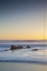 Winter Light (Ron Giesbers) Tags: light sunset seascape rocks wildatlantic castlefreke longstrand tide sun lines blue strand sand dutchman colorful sunlight shore water waves yellow leefilters 3stopsoftgrad 3stop