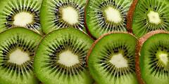 Kiwi Slices. (Through Serena's Lens) Tags: mm macromondays redux2016 myfavoritethemeoftheyear filltheframewithfood macro fruit kiwi green 7dwf slice