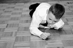 Spinning the quarter (WilliamND4) Tags: boy quarter blackandwhite blackwhite person floor monochrome