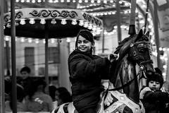 dreams and smile (Georgina ♡) Tags: portrait candid monochrome people athens greece carousel horse girl smile emotion happy fun blackandwhite lightbulbs