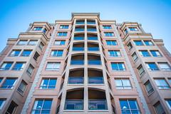Uniformity in Form (Isaac Hilman (@lightofisaac)) Tags: building tower architecture blue tan mirror symmetry symmetrical glass balcony victoria bc canada fuji fujifilm fujixseries fujixt1 fujifeed fujixclub fujixpassion fujilove photography isaachilman