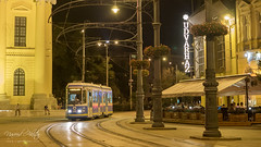 An old tram approaching infront of Protestant Great Church of Debrecen, Hungary with Lumix DMC-GX7
