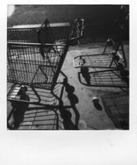 Runaways (deep_blue_sea_1956) Tags: fruit oceanside shoppingcarts impossible runaways escapees polaroidimpulse 310365 gen20bw