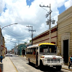 streets of Mrida ( cris  (searching for testimonials :)) Tags: road street city summer vacation bus clouds mexico calle holidays nuvole estate yucatan merida verano vacanze citt messico otw coth abigfave flickraward thebestofday gnneniyisi flickrtravelaward