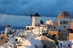 Greek flag (Nagarjun) Tags: blue sunset sun white church island volcano evening europe glow santorini caldera oia cyclades mediterranian firostefani aegeansea