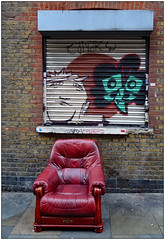 Street Furniture     (Explored) (donbyatt) Tags: shoreditch bricklane chair graffiti streetart shutters urban