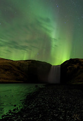 Under the lights at Skogafoss (Pete 5D...©...) Tags: waterfall iceland night dark sky lights northern skogafoss river stream reflection water motion south east coast green skies borealis cold clear star stars portrait mountain hillside hill rock formation dancing moving solar activity nature astronomy travel space weather phenomenon magnetic display natural beautiful galaxy dramatic