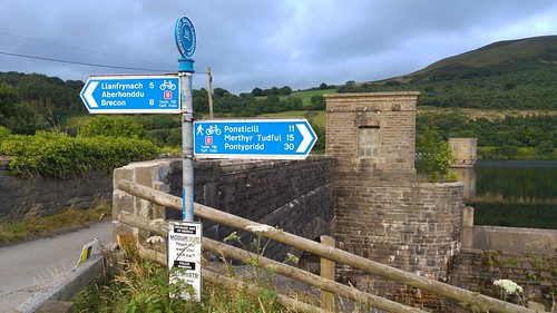 Taff Trail signpost at talybont Reservoir Dam