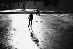 Chasing the dream (hey ~ it's me lea) Tags: hockey ice rink outdoorrink confederationpark calgary blackandwhite 52weekproject canada oursport